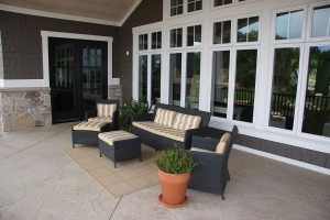 Lane Myers Custom Home Exteriors Back view with patio furniture