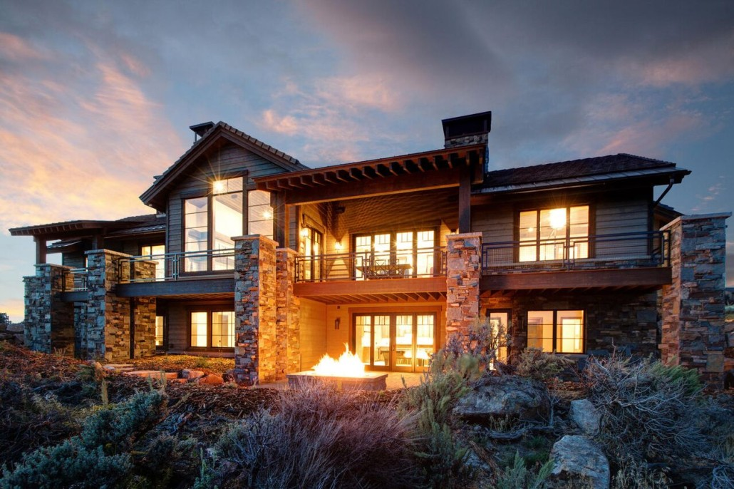 Promontory Rambler - Park City Custom Home Exterior View fom back with fire pit
