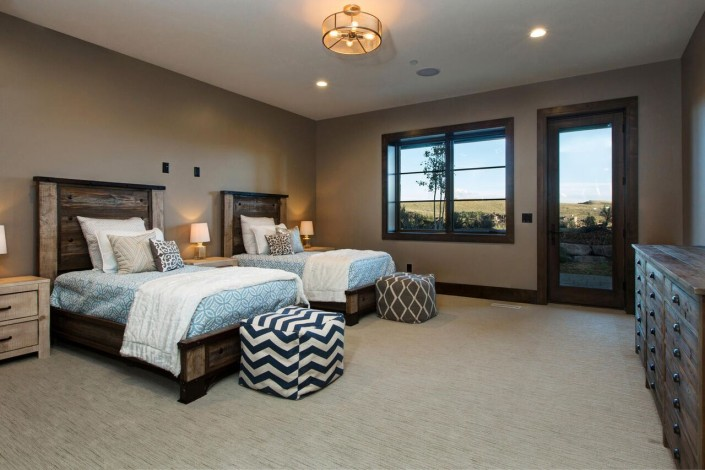 Promontory Rambler - Park City Custom Home Interior Bedroom with two beds nd exterior door