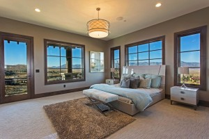Promontory Rambler - Park City Custom Home Interior Master bedroom with beautiful view