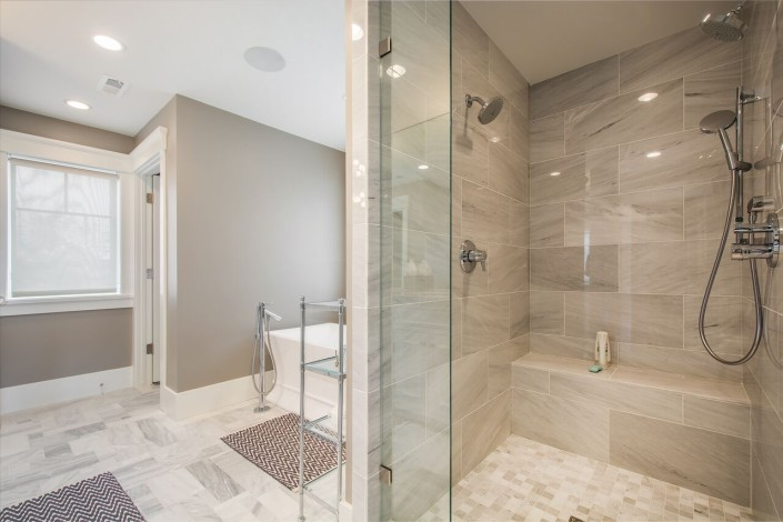 The Avenues - Salt Lake Custom Homes Interior Bathroom with walkin shower and bathing tub