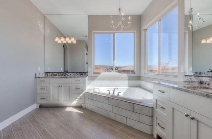 Washington Vistas - St. George Custom Homes Interior bathroom with corner window view