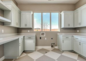 Washington Vistas - St. George Custom Homes Interior laundry with view of outside